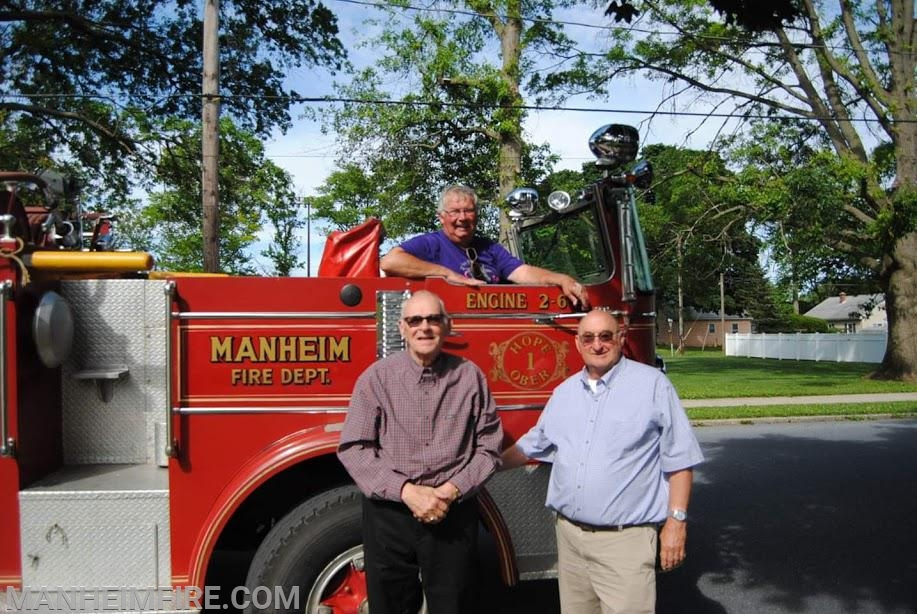 Past Fire Co. President Dennis Ober in cab, former Asst. Fire Chief Dale Stauffer, and Past Fire Chief Jim Reed.