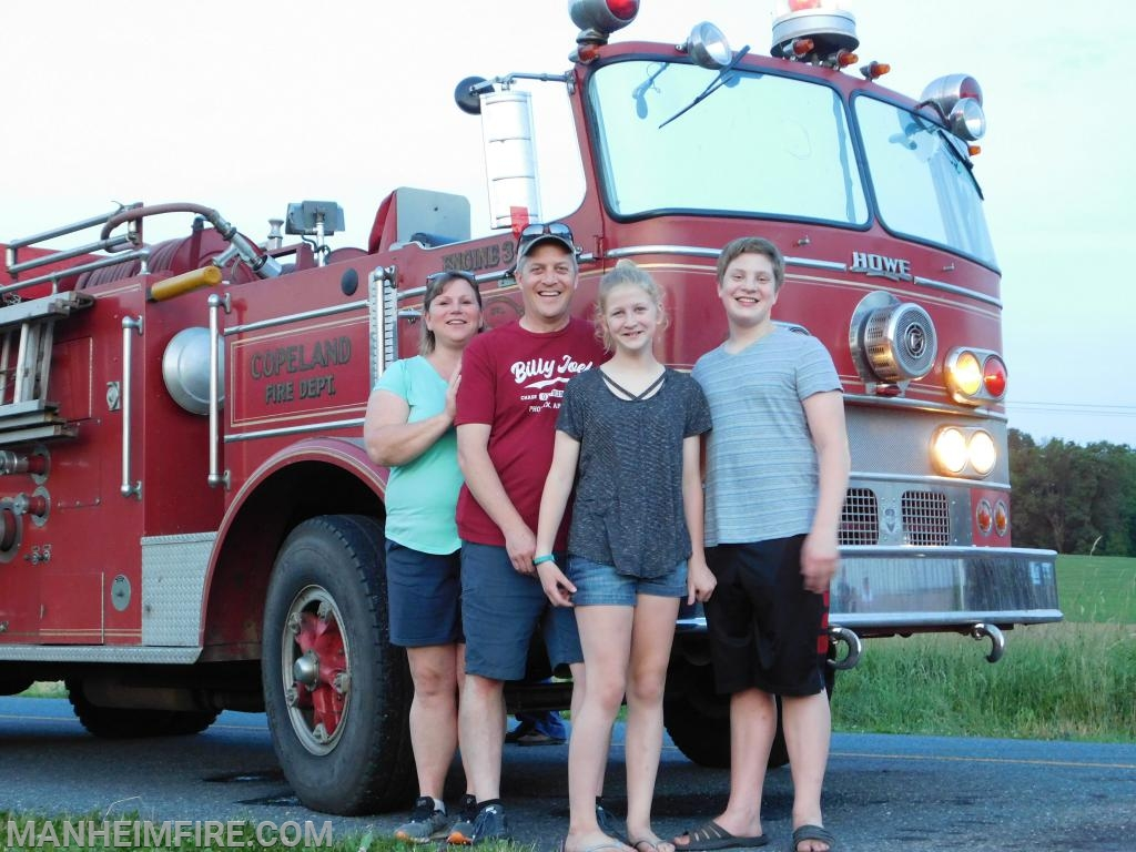 The Obers in front of Howie when it arrived June 6th (Gina, Duane, Kaylee, Riley)