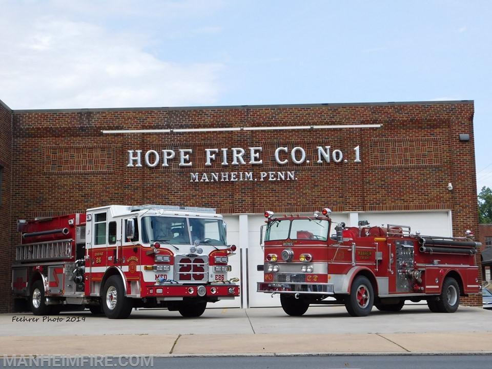 Manheim FD's new 2019 Pierce pumper and the 1970 Howe pumper.
