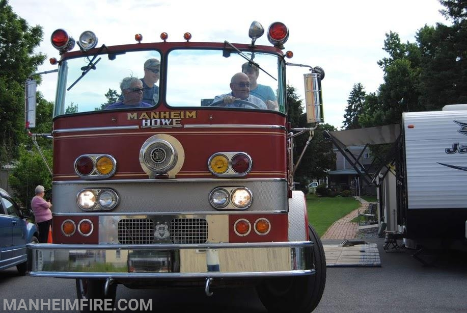 Past Chief Jim Reed taking Howie for a spin. Chief Reed's dad, Elton Reed, was the salesman for Howe, who sold the pumper to Manheim FD in 1970.